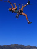 Female Rock Climbers Hang off Rope Photographic Print by Greg Epperson