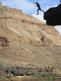 Man Jumping off Cliff, Grand Canyon Natl Park, AZ Photographic Print by Amy And Chuck Wiley/wales