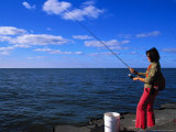 Woman with Fishing Rod, Grand Haven, MI Photographic Print by Barry Winiker