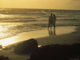 Aruba, Couple Walking on Beach Photographic Print by Jennifer Broadus