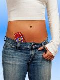 Woman with Cell Phone Tucked Into Her Jeans Photographic Print by John James Wood