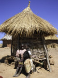 Children by Straw Huts, South Africa Psters por Ryan Ross