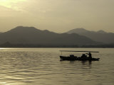 Twilight View of a Small Boat on West Lake, China Posters by Ryan Ross