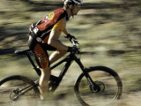 Close up of Fast Moving Mountain Biker, Mt. Bike Photographic Print by Michael Brown