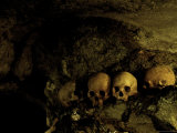 Skulls in Caves, Indonesia Print by Michael Brown