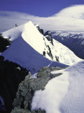 Climber Standing on Ridge on Mt. Aspiring, New Zealand Posters by Michael Brown