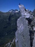 Climber on the Summit of a Rock Tower, Chile Fotografisk tryk af Pablo Sandor