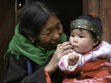 Woman with Child, Tibet Photographic Print by Michael Brown