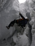 Climber in Crevasse, Switzerland Photographic Print by Michael Brown