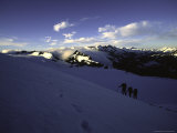 Climbers Follow Footsteps in the Snow, New Zealand Photographic Print by Michael Brown