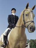 Low Angle View of a Jockey Sitting on a Horse Lámina fotográfica