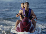 A Couple Riding a Jet Ski in the Sea Photographic Print