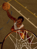 High Angle View of a Young Man Playing Basketball Photographic Print