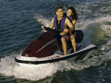 Mid Adult Couple Riding a Jet Ski Photographic Print