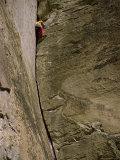 Rock Climber Scaling Rock Face Photographic Print