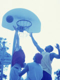 Low Angle View of Young Men Playing Basketball Photographic Print
