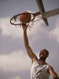 Man Slam-Dunking a Basketball Photographic Print