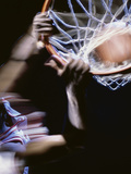 High Angle View of a Man Slam Dunking Photographic Print