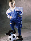 Portrait of a Boy Standing with His Foot on a Soccer Ball Photographic Print