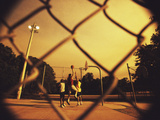 Three Men Playing Basketball Photographic Print