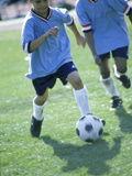 Two Soccer Players Chasing a Soccer Ball Photographic Print