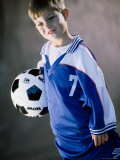 Child Holding a Soccer Ball Photographic Print