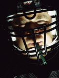 Portrait of an American Football Player Wearing a Helmet Photographic Print