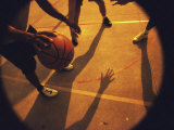 Low Section View of Three Men Playing Basketball Photographic Print