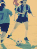 Teenage Girls Playing Soccer Photographic Print
