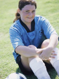 Portrait of a Teenage Girl Sitting on a Lawn with a Soccer Ball Photographic Print