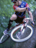 Young Man on a Bicycle Photographic Print