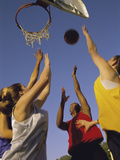 Low Angle View of a Group of Young People Playing Basketball Photographic Print