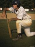 Baseball Player Resting on a Baseball Bat Photographic Print