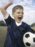 Boy Holding a Soccer Ball Photographic Print