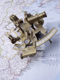 Antique Sextant on a Map Photographic Print