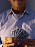 Mid Section View of a Man Holding Playing Cards Photographic Print