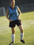 Teenage Girl on a Soccer Field Photographic Print