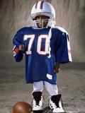 Boy in an Oversized Football Uniform Wearing a Helmet Photographic Print
