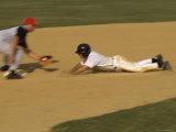 Baseball Player Sliding into a Base Photographic Print