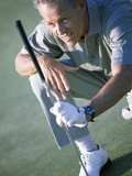 Senior Man Holding a Golf Club Photographic Print