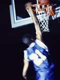 Rear View of a Teenage Boy Playing Basketball Photographic Print