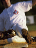 Low Angle View of a Baseball Player Sliding on Base Photographic Print