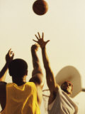 Low Angle View of Two Young Men Playing Basketball Photographic Print