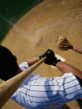 High Angle View of a Baseball Player Swinging a Baseball Bat Photographic Print