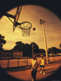 Three Young Men Playing Basketball Photographic Print