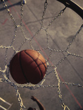 High Angle View of a Basketball in a Net Photographic Print