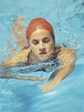 Young Woman Swimming in a Swimming Pool Photographic Print
