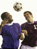 Two Soccer Players Jumping to Head a Soccer Ball Photographic Print