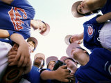Low Angle View of a Group of Boys on a Baseball Team in a Huddle Photographic Print