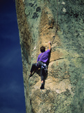 Scaling the Rockface Photographic Print